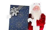 Composite image of santa claus showing blackboard