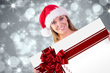 Composite image of festive blonde smiling at camera
