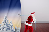 Composite image of santa claus pulling rope