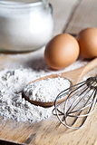flour, eggs and kitchen utensil