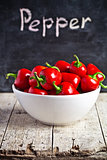 red hot peppers in bowl and blackboard