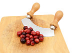 Whole fresh cranberries with a rocking knife