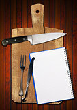 Empty Notebook on Old Cutting Board