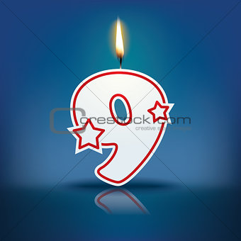 Candle number 9 with flame