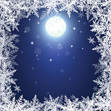 Christmas snowflakes and moon on dark blue background.