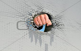 Fist punching through brick wall