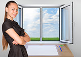 Beautiful businesswoman in dress smiling and looking at camera. Open window as backdrop