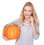 Happy woman with Thanksgiving pumpkin