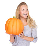 Cheerful female with festive pumpkin