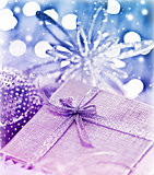 Purple blue Christmas gift with baubles decorations