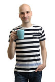 Young casual man with cup of coffee