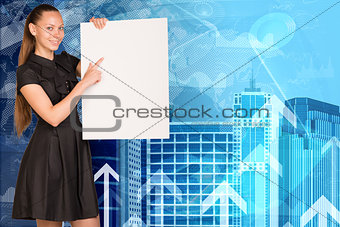 Beautiful businesswoman in dress holding empty paper sheet. Buildings and arrows as backdrop
