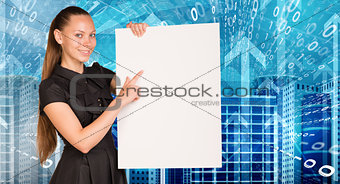 Beautiful businesswoman in dress holding empty paper sheet. Buildings, figures and arrows as backdrop