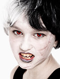 Young Girl in Wig Posing as Vampire