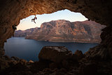Female rock climber on a cliff in a cave at Kalymnos