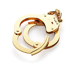 Gold handcuffs isolated