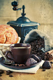 Cup coffee with grain and croissants