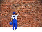 house painter paints brick wall