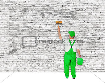 painter covers white  brick wall