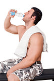 Attractive athlete drinking water isolated.