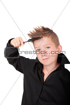 Boy brushing hair.