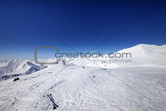 Ski poles on snow slope at nice day