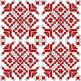 Red and black ethnic ornaments over white background