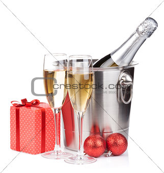 Christmas champagne in bucket and gift box