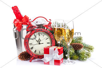 Champagne, gift boxes and christmas clock