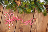 Christmas background with snow fir tree and candy canes