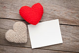 Photo frame or greeting card and valentines day toy hearts