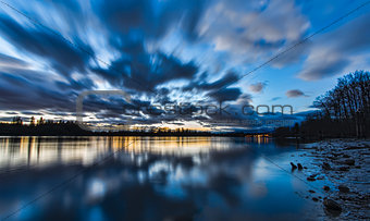Blue Blurred Moving Clouds Over River