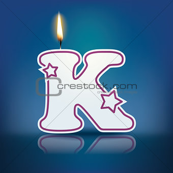 Candle letter K with flame