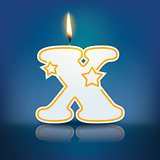 Candle letter X with flame