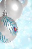 silver Christmas ball on blue bokeh