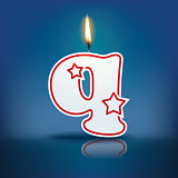 Candle letter q with flame