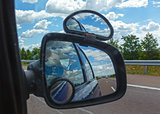 Reflection of sky with clouds in mirror.