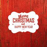 Vintage Christmas Label On Red Hardwood Texture