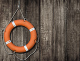 Lifebuoy on old wood background
