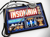 Insomnia on the Display of Medical Tablet.