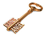 Business Angel - Golden Key on White Background.