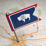 Wyoming Small Flag on a Map Background.