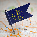 Indiana Small Flag on a Map Background.