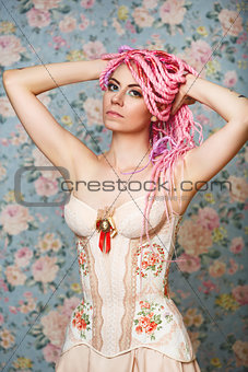 Freaky young female model wearing corset