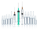 syringes with needles and medical ampoules on an isolated white
