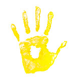 handprint yellow paint on a white background isolated