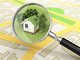 City building in tne magnifier. House search concept.