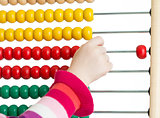 Kid's hand with colorful abacus isolated