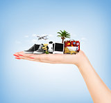 Travel concept. Hand holding atribute of travel and holiday.