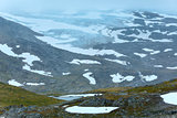 Summer mountain with lake and snow (Norway)